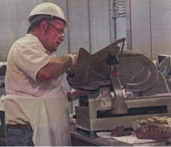 Dewig Bros. Packing Co. employee, Kent Hollander slices up meat for a customer recently at Dewig Bros. Packing Co