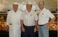 On the left is Tom Dewig, center Dean Dewig, right Kent. Sausage Maker, Aaron Kiesel